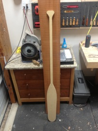 The prototype paddle against the mahogany board
