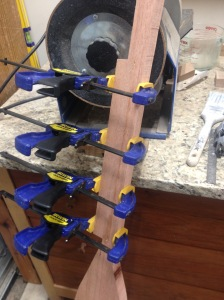 Clamps holding together the wood on my saw-scarred paddle.