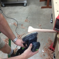 Shaping the grip with the orbital sander